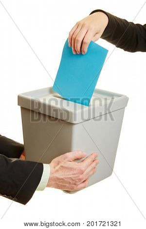 Hands of business people introducing a ballot paper in a ballot box