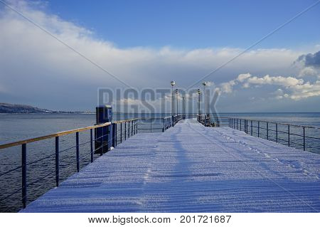 Marine boat dock in a sub-tropical country under a layer of snow