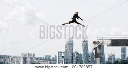 Business woman jumping over huge gap in concrete bridge as symbol of overcoming challenges. Cityscape on background. 3D rendering.