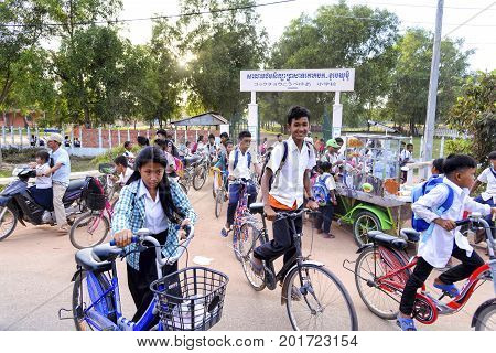 Siem Reap, Cambodia - January 06, 2017: Students exiting from school in Siem Reap, near the famous Angkor Wat temple. This school was donated by a group of japanese citizens from the city of Kobe