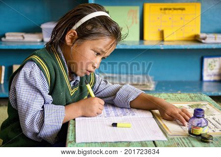 Leh, India - August 24, 2015: View of a concentrated tibetan student in SOS Children's Village school. Children's Village is an integrated educational community for destitute Tibetan children in exile