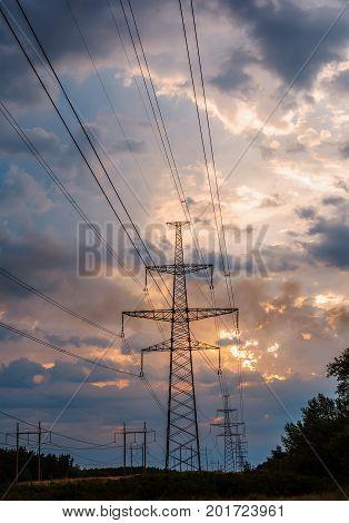 high voltage post. High-voltage tower sunset background.