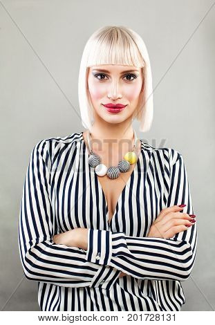 Blonde Beauty. Pretty Woman Fashion Model with Blonde Bob Haircut
