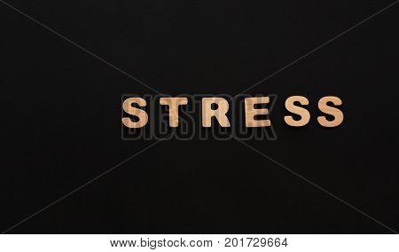 Word Stress on black background. Depression, frustration, deadline concept