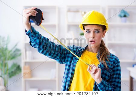 Woman in workshop with measuring tape