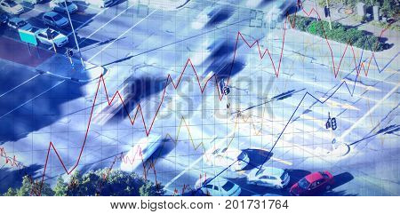 Stocks and shares against high angle view of cars on street