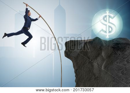 Businessman pole vaulting towards his money goal