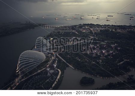 Singapore - April 2015: Is approaching storm and ships in the Straits of Singapore from the viewpoint on the Marina Bay Sands Hotel