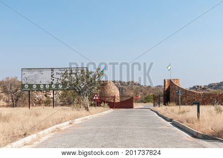 ETOSHA NATIONAL PARK NAMIBIA - JUNE 27 2017: The Galton Gate at the Western border of the Etosha National Park in Namibia