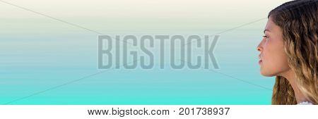 Digital composite of Side portraiture of millennial woman against light blue background
