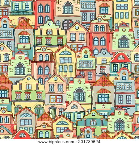 Seamless pattern with doodles colored scandinavian houses . Vector background .