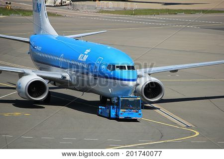 Amsterdam The Netherlands - May 26th 2017: PH-BGU KLM Royal Dutch Airlines Boeing 737 pulled away from gate at Schiphol International Airport