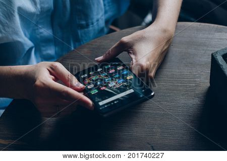Moscow RUSSIA - August 20th 2017: Hands using smartphone One Plus 3T with icons of social media on screen. Smart phone life style mobile phone era in everyday life.