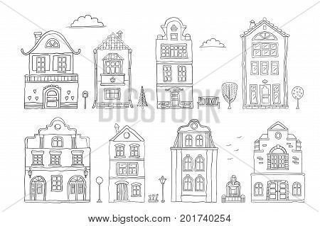 Set of contour houses on white . Vector doodles .