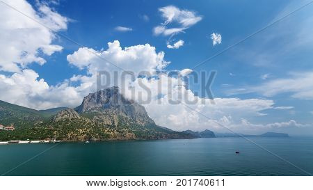 Bolvan mountain Crimea / Sunny summer day the mountain is immersed in clouds