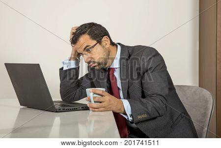 Arab Man Woking In His Laptop In The Kitchen