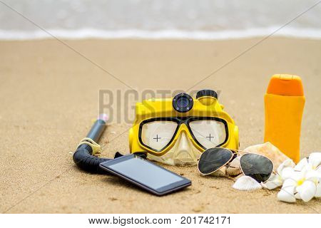 Summer on beach and accessories sun glasses sunblock hat snorkel slippers