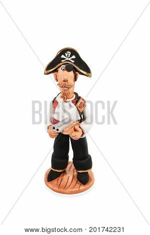 Clay figurine of a one-eyed pirate with a gun isolated on a white background
