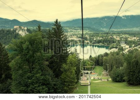 Lake Bled Slovenia July 14 2017 Cable cars over Lake Bled Slovenia toned