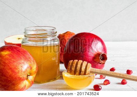 Honey apple and pomegranate. traditional food for Jewish New Year Holiday Rosh Hashana