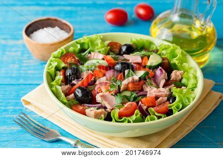 Salad With Vegetables And Tuna On Rustic Blue Wooden Table