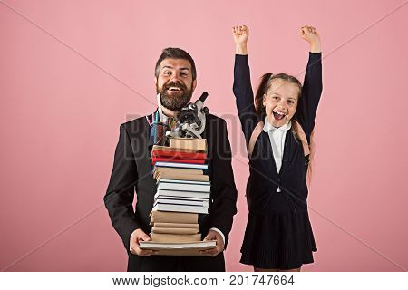 Girl In School Uniform And Bearded Man. Father And Schoolgirl