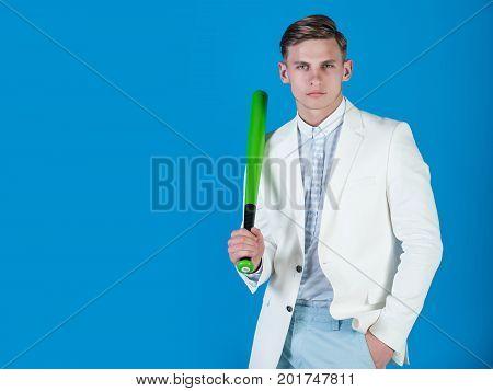 Man Holding Green Bat