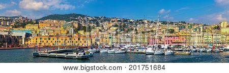 Panoramic view of the port Genoa ( Genova ) Italy. View from the sea to the old town on summer sunny day. Genoa bay harbor yacht at the pier. Center of the Ligurian Riviera.Tourist destinations