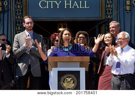 San Francisco CA - August 25 2017: City Board of Supervisors President London Breed speaks to the crowd at the Unite Against Hate rally at Civic Center in front of City Hall in San Francisco.