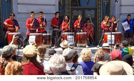 San Francisco CA - August 25 2017: Asawa School of the Arts performed taiko drums for the crowd at the Unite Against Hate rally at Civic Center in front of City Hall in San Francisco.