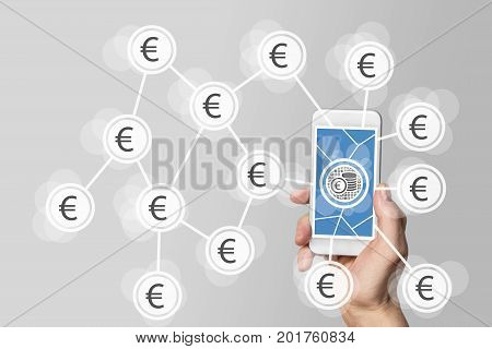 Mobile e-payment and e-commerce concept with hand holding modern smartphone in front of neutral white background