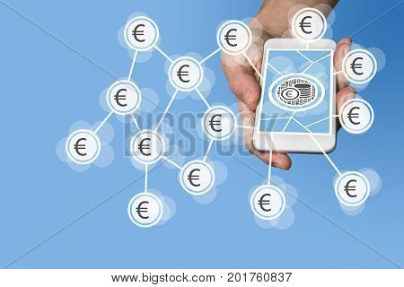 Mobile e-payment and e-commerce concept with hand holding modern smartphone in front of neutral blue background