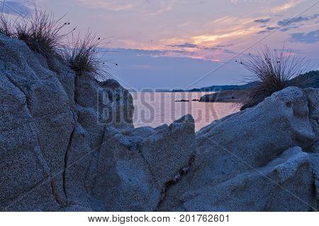 Rocks, sea and sunset at the coast of peninsula Sithonia, Greece