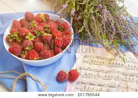 berries of a raspberry, breakfast, good morning, good mood, raspberry and notes, Raspberry on the table with notes and bouquet of screech, summer mood