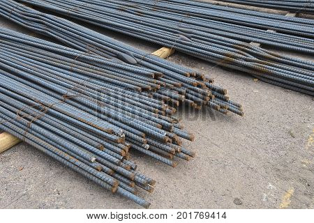 Piles of rebar and reinforcing rod used for a construction project in strengthening concrete