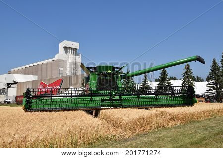 MOORHEAD, MINNESOTA July 22, 2017: Anheuser-Busch sponsored Grower Days honoring farming who grow barley for the malting process which included displaying A John Deere self propelled combine in the adjacent barley field.