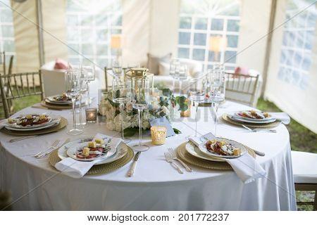 Elegant table set up for dinner in tent