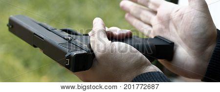 Loading Handgun. Reloading handgun. Man  Reloading handgun. poster