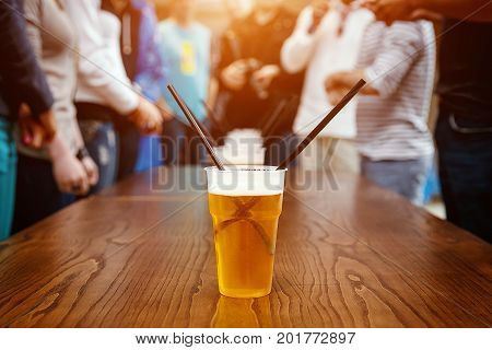 plastic beer glass with Tubules on a party
