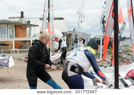 ST. PETERSBURG, RUSSIA - JULY 5, 2017: Training in sailing on 29er dinghy in the Gulf of Finland near the yacht club of St. Petersburg. Yacht club organizes sailing classes for all ages