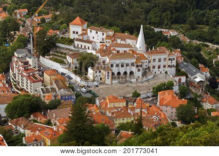 SINTRA, PORTUGAL - MAY 10, 2017: Aerial view to the National Palace of Sintra, the medieval royal residence in Portugal. Since 1995, the cultural landscape of Sintra is listed as UNESCO World Heritage