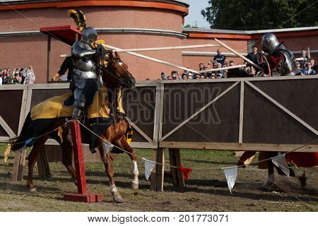 ST. PETERSBURG, RUSSIA - JULY 9, 2017: Armored knights on horses participating in the jousting tournament during the military history project Battle On Neva at St. Peter and Paul fortress