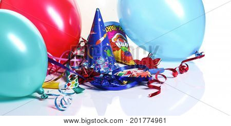 Party decoration - balloon, party hats isolated on white background
