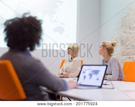 Group of a young business people discussing business plan at modern startup late night office building