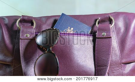 Travel Concept With Passport In Carry Bag.