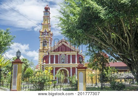 COATEPEC, VERACRUZ, MEXICO- AUGUST 7, 2017: Facade of San Jeronimo church in a sunny day in Coatepec, Veracruz, Mexico