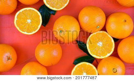 Oranges On Orange Wood Table Overhead.