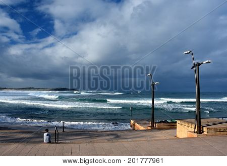 Dramatic sky with large clouds over Dee Why beach and Tasman sea (NSW Australia)