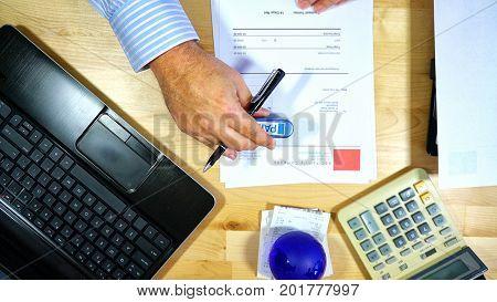 Accountant Paying Invoices.