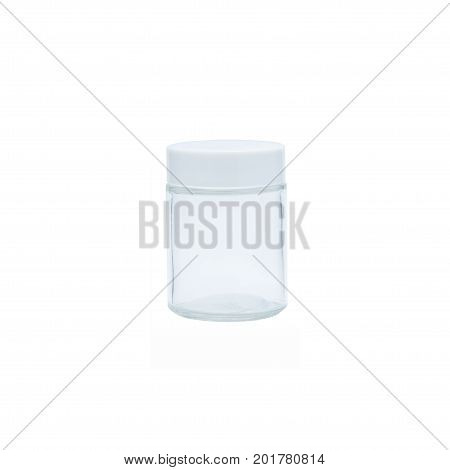 Prescription medication container in glass over a pure r255 g255 b255 white background.